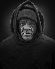 Tyrone (mckenziemedia) Tags: man homeless homelessness people hood hat hoodie sweatshirt scarf face portrait portraiture blackandwhite monochrome chicago city urban street streetphotography