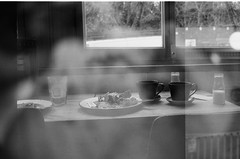 Two Tea Cups (kiranmp) Tags: olympustrip35 ilfordxp2 blackandwhite bw monochrome london 35mmfilm lightshadow blancoynegro grayscale monochromatic cafe breakfast