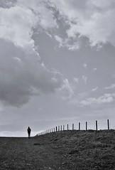 Big Skies (3), Avebury, April 2016 (Mano Green) Tags: person silhouette fence sky cloud skies big portrait black white grey figure canon canonet 28 ilford xp2 super 400 35mm film avebury wiltshire england april spring 2016