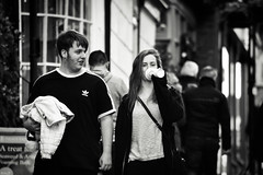 Sharing a Joke (Bury Gardener) Tags: burystedmunds bw blackandwhite britain monochrome mono england eastanglia 2018 nikond7200 nikon suffolk streetphotography street streetcandids snaps strangers candid candids people peoplewatching abbeygatestreet