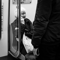 Commuter (Go-tea 郭天) Tags: qingdao shandong chine cn commuter inside indoor metro car seat seated old lady woman grandma passengers bag mobile phone cellular cell cellphone talking conversation busy commute commuting travel traveling portrait street urban city people candid bw bnw black white blackwhite blackandwhite monochrome naturallight natural light asia asian china chinese canon eos 100d 24mm prime passenger