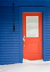 Red Door (Karen_Chappell) Tags: red door blue house home paint painted wood wooden clapboard architecture building colourful colours colour white snow winter thebattery stjohns newfoundland nfld canada atlanticcanada avalonpeninsula eastcoast city urban window
