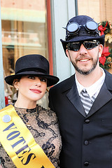 Time Travelers? (wyojones) Tags: texas galveston dickensonthestrand christmas holiday festival lady woman girl hat dress brunette sash smile lips browneyes beauty pretty cute pendant earring suffragette womansvote man gentleman googles shades sunglasses suit tie beard steampunk timetravelers airship