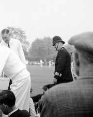 Just missed Norman Wisdom! (vintage ladies) Tags: vintage blackandwhite photograph photo man male cricket police policeman