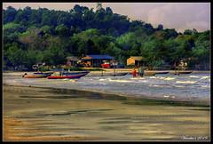 Fishing village (VERODAR) Tags: village fishingvillage sea beach hill jungle sky clouds evening eveninglight eveningsky boat wave sand family hut house nikon verodar veronicasridar