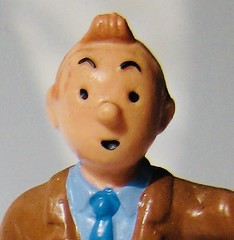 Tintin Portrait 4518 (Brechtbug) Tags: tintin plastic figure head 2010 snowy dog comics cartoon character by herge comic strip action from belgium french toy toys statue sculpture tin captain haddock run running trench coat