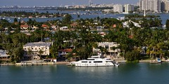 Palm Island and beyond, looking north, Miami Beach, Florida.. (edk7) Tags: nikond60 edk7 2012 us usa florida miami miamibeach palmisland shoreline water residentialskyscraper architecture building structure city cityscape urban boat yacht palm tree