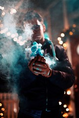 Stay right here and let the cosmos twirl. (Saragraphs) Tags: sad photography emotional art love blue smokebomb smoke bokeh citylights lights christmas winter 50mm sigmaart sigma canon