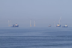 "on a sleep, hazy, summer afternoon oil supply vessels pass near gleaming wind turbines, viewed from Torry Point, Girdle Ness, Aberdeen, Scotland (grumpybaldprof) Tags: canon 7d ""canon7d"" sigma 150600mm f563 ""dgoshsmsport"" ""sigma dgoshsmsport"" aberdeen ""aberdeencity"" ""granitecity"" grampian scotland uk ""beautifulcity"" ""northeastscotland"" aberdeenshire ""girdlenesslighthouse"" 1833 ""girdleness"" ""greyhopebay"" ""torrypointbattery"" ""foghorn"" lighthouse ""aberdeenport"" torry ""aberdeenbaywindfarm"" ""europeanoffshorewinddeploymentcentre"" eowdc offshore windfarm windturbines ""offshorewindfarm"" turbines blackdog ""bridgeofdon"" longshot"