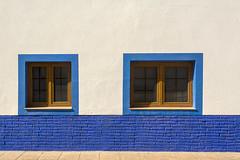 Two blue windows (Jan van der Wolf) Tags: map181295vv blue windows wall muur fuerteventura elcotillo ramen gevel facade dissymmetry