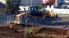 (Rich T. Par) Tags: pomona phillipsranch socal southerncalifornia losangelescounty lacounty constructionsite california palmtrees tree road suburb dirt civilengineering tubes pipes tractor frontloader heavyequipment firehydrant alleyway fence chainlinkfence