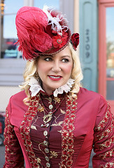 Glance Toward Her Companion (wyojones) Tags: texas galveston dickensonthestrand holidayfestival hat dress blond hair girl lady lovely woman beautiful beauty feathers smile pretty curls lace red