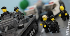 LAPD stops a German Tank when it runs a red light.  The tank commander claims he's lost and heading to the Russian Front. (Brick Police) Tags: lego wwii ww2 legomilitary lapd cops
