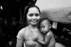Mother and Child - Manila, Philippines (LA Street Moments) Tags: asia manila philippines bnw bw blackandwhite child mother family street documentary realstreet love rawstreet portraits leica leicaq tondo
