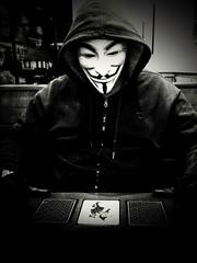Pic a card (2 of 4) (PhotoJester40) Tags: indoors inside masked mask guyfawkesmask noirblanc blackandwhite blackwhite bnw bw jokercards posing me memyselfandi amdphotographer goth gothic mysterious 2of4 male