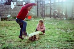 Seesaw (hiphopmilk) Tags: copyright©jaredyehwooehmoehfilms konica offroad 現場監督 zoom 35mm 135film film analog analogue jaredyeh hiphopmilk kodak travel china sichuan aba hongyuan tibetan qiongxi village yard workshop kids children playground seesaw bricks photography