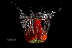 Strawberry Splash (Inky-NL) Tags: lowkey hmm macromondays thefirstletterofmysurname splash strawberry fruit food water waterdrops plons splashphotography flash mm movement blackbackground action