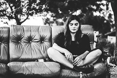 Sitting Outside (Trent Crawford) Tags: blackandwhite bw grayscale black white person people portrait girl sit sitting couch outdoors boots