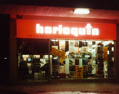 Harlequin (Beardy Vulcan II) Tags: basingstoke harlequin record cassette cartridge recordshop recordstore shop store night nocturnal newmarketsquare festivalplace towncentre downtown hampshire england autumn fall november 1975 20thcentury