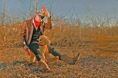 The Lone Ranger (Philip Bonneau) Tags: loneranger ranger cowboy horse rockinghorse gun toy toygun cowboyhat vest outdoors tumbleweed boots leather brown grass pretend imagination wood portrait mask bandit