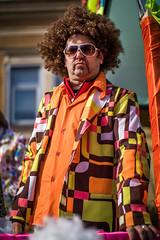 Man at carnival with a Disco Stu hair style and colorful outfit (Ivan Radic) Tags: discostu frisur haarstyl harschnitt kostüm mann carnival costume disco hairstyle man viltroxefeosm2 speedbooster focalreducer canon50mmf14usm canoneosm50 mirrorless spiegellos evil cscilc prime systemcamera systemkamera mödling österreich austria fasching faschingsumzug 2019 karneval ilc csc ivanradic