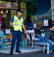 Police (Beegee49) Tags: street people policeman watching happy planet luminar sony a6000 bacolod city philippines asia