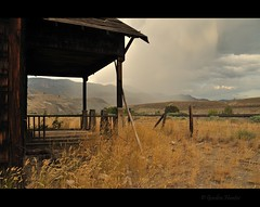 rain on me (Gordon Hunter) Tags: rain shower storm clouds weather old abandoned house home shack station porch veranda dry arid grass fence desert wood decay earth cache creek kamloops thompson bc canada gordon hunter nikon d5000 places