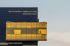 Yogi in the Amber Box (Sam Wagner Photography) Tags: yoga amber box person telephoto close up dusk detail guthrie theater unique architecture minnesota minneapolis midwest america usa building peaceful serene