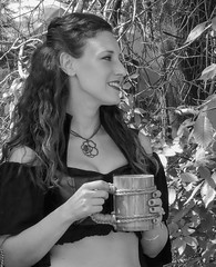 The Rose (clarkcg photography) Tags: woman drink mug stein cup necklace rose rosecutout renaissance blackandwhite blackwhite bw candid cof053 peoplecloseup cof053mari