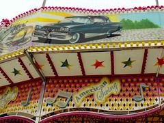 Lights, Stars And Scenery On American Swing. (dccradio) Tags: myrtlebeach sc southcarolina robesoncounty outdoor outdoors outside amusementpark park broadwayatthebeach pavilionpark pavilionparkcentral pavilionamusementpark pavilionamusementparkcentral carnival midway fairride amusements amusementdevice mechanicalride ride rides thrillride outdooramusement fun entertainment nikon coolpix l340 bridgecamera sky cloudy overcast greyskies grayskies color colorful car lights scenery musicnotes musicalnotes star stars swingbuggy americanswing bertazzon musicride himalaya flyingbobs thunderbolt