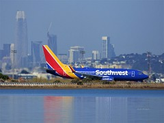 Southwest at the Bay (Anton Shomali - Thank you for over 2 million views) Tags: fog salesforcecenter downtown blue red yellow boeing 737 airport airlines southwest flying fly bay southwestatthebay sanfranciscointernationalairport sfo taxing takeoff airline plane 747 jumbojet travel reflections city buildings runway panasonic dmcfz70 san francisco sf sanfran 49ers sanfrancisco ca california engine wind