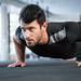 Man doing push ups in gym