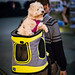 Man carrying a dog in a backpack