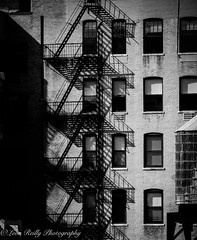 Upper West Side Apartments, NYC (broadswordcallingdannyboy) Tags: nyc ny newyorkcity city usa us america eastcoast newyork copyrightleonreillyphotography light holiday leonreilly eos7d eflens cityscape canon winter newyorkwinter creative lightroom metropolis iconic february2019 donotcopy newyorkstateofmind newyorkminute bw mono blackandwhite mood atmosphere dramatic nycbw newyorkcitybw upperwestside apartmentblock fireescape shadows leonreillyphotography