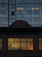 ladder in window :: glow (dotintime) Tags: ladder construction remodel repair window pane glass glow light downtown urban dark contrast old new dotintime meganlane
