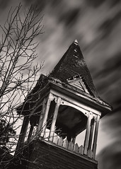 Faith Abandoned (Mike Schaffner) Tags: abandoned bw belfry blackwhite blackandwhite bulb chapel church clouds decay decayed derelict deserted dilapidated longexposure monochrome old ruins steeple tree