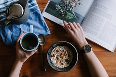 person holding blue ceramic mug and white magazine - Credit to https://myfriendscoffee.com/ (John Beans) Tags: coffee breakfast tea magazine cafe coffeebeans shopbeans espresso coffeecup cup drink