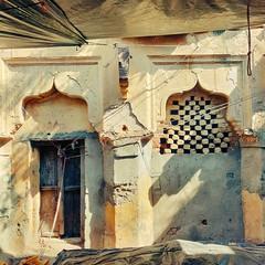 Modest Ingenuity. (Gattam Pattam) Tags: arch heritage texture sun light yellow shadow wall jali old door window orchha india architecture
