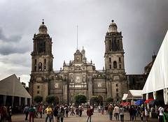 Mexico City Metropolitan Cathedral in Mexico City, Mexico (` Toshio ') Tags: toshio mexicocity mexico mexicocitymetropolitancathedral zócalo people crowd market church religion cathedral catholic architecture centralamerica iphone umbrella clock tents