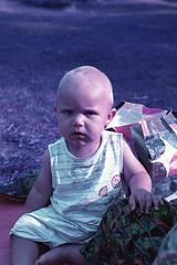 Beach Bum (Magnus Bergström) Tags: 35mm film analog canonae1 canon lomography lomo xr100400 purple lomochrome xr 100 400 100400 lomochromepurplexr100400 sverige sweden epson scanner v500 epsonv500 summer värmland kil vänern frykstabaden lake kid child boy portrait beach tagfal00
