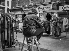 IMG_1140186 (Kathi Huidobro) Tags: urban streetscene perched candid streetphotography london eastlondon blackwhite bw monochrome marketstalls petticoatlane streetmarket stepladder