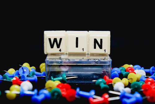 Win text with pins on black background