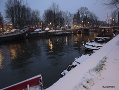 Amsterdam. (alamsterdam) Tags: amsterdam snow evening boats water canal brouwersgracht cars architecture reflection