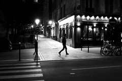 Crossing the lit passage (pascalcolin1) Tags: paris13 homme man nuit night chemin passage lumière light lampadaires lamppost passagepiéton crossing traversant crossroads photoderue streetview urbanarte noiretblanc blackandwhite photopascalcolin 50mm canon50mm canon