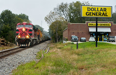 DG + FXE = MS? (weshendrix) Tags: cn canadian national yazoo subdivision pocahontas mississippi ms train railfan railfanning railroad railroading rr freight grain ge es44ac fxe ferromex gevo diesel engine locomotive vehicle outdoor autumn rain store sky grass