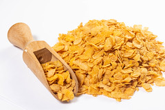 Pile of Corn Flakes with wooden measuring Spoon (wuestenigel) Tags: maize dry crunchy crisp sweet grain background snack corn flake pile golden isolated yellow energy white crispy fiber closeup breakfast healthy diet food cereal ingredient cornflakes nutrition morning tasty health heap nobody organic macro meal noperson keineperson lebensmittel gesund ernährung gesundheit frühstück müsli mahlzeit refreshment erfrischung delicious köstlich diät desktop trocken wheat weizen mais nahansicht süss lecker cooking kochen wood holz