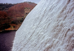 full flow (Ron Layters) Tags: derwentdam fullflow water overflow winter trees derwentreservoir tower wintercolours manmadewaterfall spray derwentvalley derwent dam waterfall peakdistrict fairholmes england derbyshire thedarkpeak upperderwent unitedkingdom slidefilmthenscanned slide transparency fujichrome velvia leica r6 leicar6 ronlayters highestpositioninexplore164onfridaymarch152019 explore interesting explored 25 5k