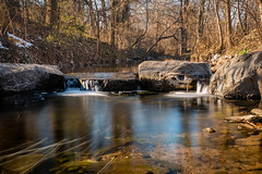 Quiet Pool at Base of Small Waterfall (John Brighenti) Tags: sunny outdoors afternoon rock rockcrest rockville twinbrook maryland md water creek river stream flow liquid shallow winter january photography sonyshooter sony alpha a7rii ilce7rm2 stroll hike path walk nex ilce emount femount longexposure waterfall falls crashing ice icicle rocks sel28f20