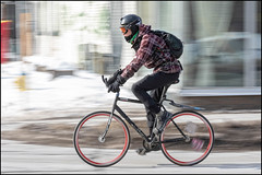 Winter Cycling Girl on Bank Street (Dan Dewan) Tags: dandewan goggles winter street february canon colour snow cyclist ottawa lady sunday girl bike woman backpack ontario canada canonefs18135mm13556is 2019 bicycle bankstreet