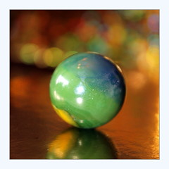 I dream a world (overthemoon) Tags: macromondays redux2018 glass holidaybokeh gold square frame marble bille toy jouet green blue yellow lessthananinch circles multicolour reflection imperfection poem langstonhughes backintheday